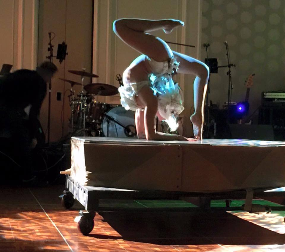 Glowing Contortionist Tina Phoenix in White